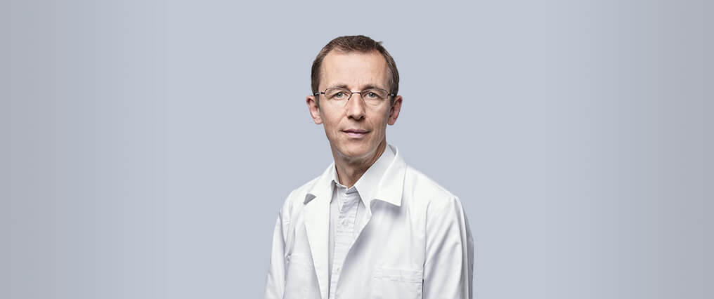 Dr CLAUDE OPPIKOFER